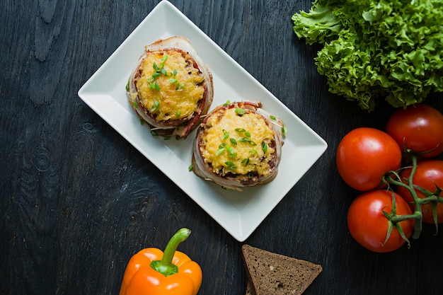 Baked minced cheese with slices of bacon
