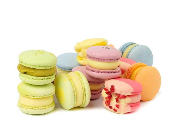 Baked multicolored macarons with different flavors on white isolated background