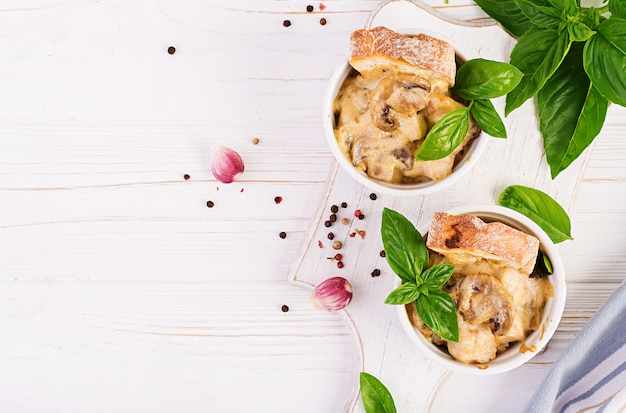 Baked mushroom julienne with chicken, cheese and toast