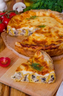Baked pancakes (crepes) with mushrooms and bechamel sauce