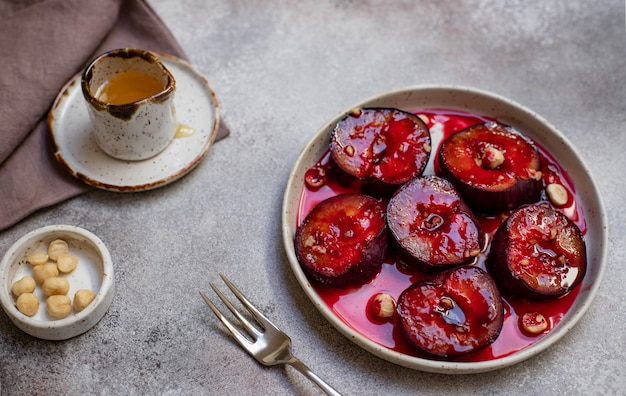 Baked plums with honey, cinnamon and hazelnuts