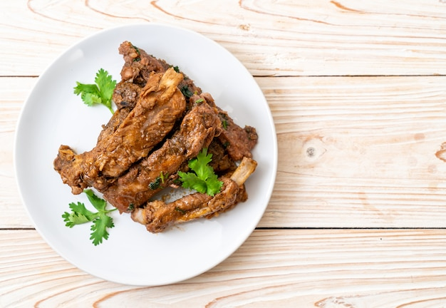 Baked pork ribs with sauce and vegetable