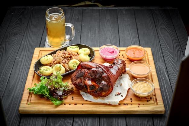 Baked pork shank with sauerkraut with bigus