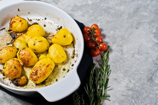 Baked potatoes in a baking dish.