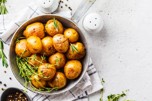 Baked potatoes in a cast iron skillet, top view.