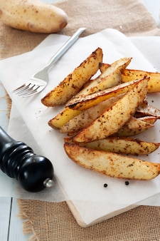 Baked potatoes on table, vintage and country style kitchen