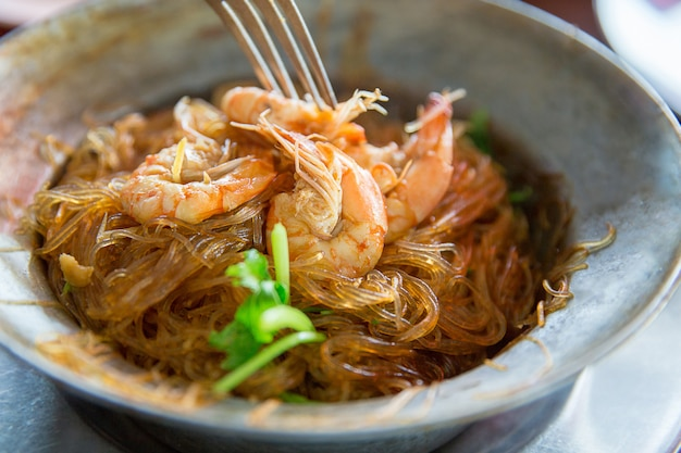 Baked prawns with vermicelli in focus selective