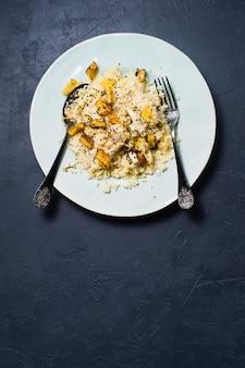 Baked pumpkin and quinoa. vegan healthy food.