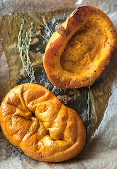 Baked pumpkin with herbs on the tray