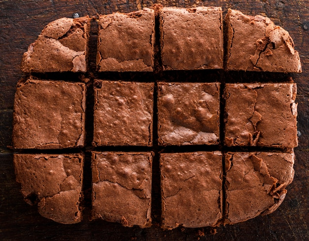 A baked rectangular chocolate brownie pie is cut into squares