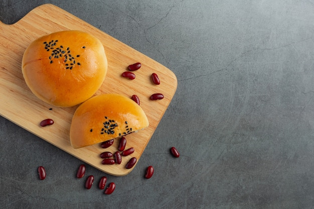 Baked red bean paste buns on wooden cutting board