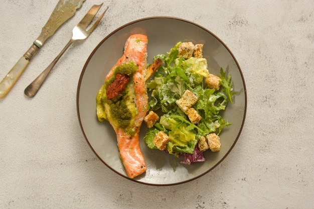 Baked salmon and healthy salad. top view. healthy food.