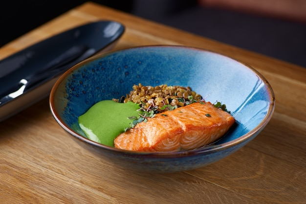 Baked salmon with green lentils. macrobiotic food concept.