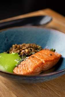 Baked salmon with green lentilson the table, serving in a restaurant.