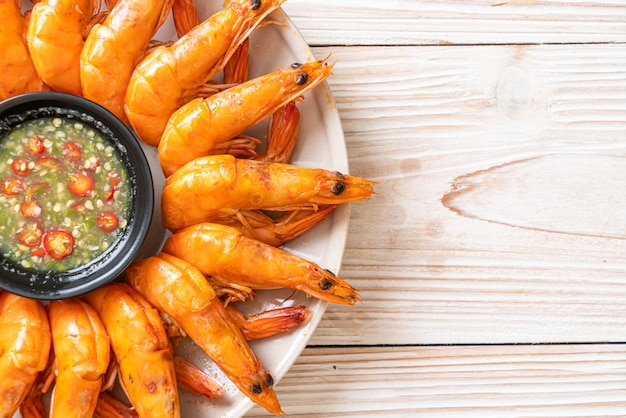 Baked salted shrimps or prawns with seafood spicy sauce