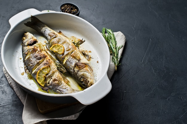 Baked sea bass in a baking dish.