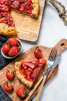 Baked strawberry and rhubarb pie on the table