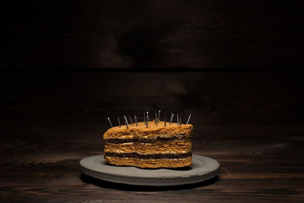 Baked sweet cake on a concrete plate on a dark wooden background. for diet advertising