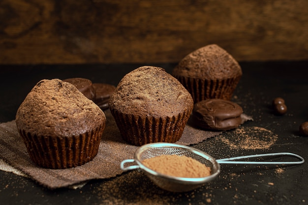 Baked tasty cupcakes with strainer