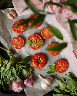 Baked tomatoes garlic and aromatic herbs