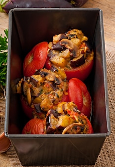 Baked tomatoes stuffed with eggplant and mushrooms