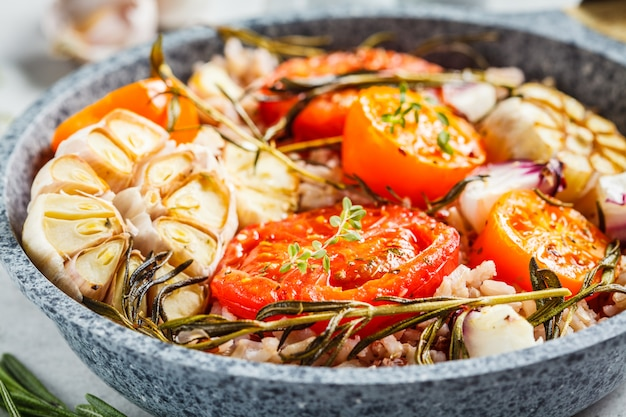 Baked tomatoes with brown rice in pan
