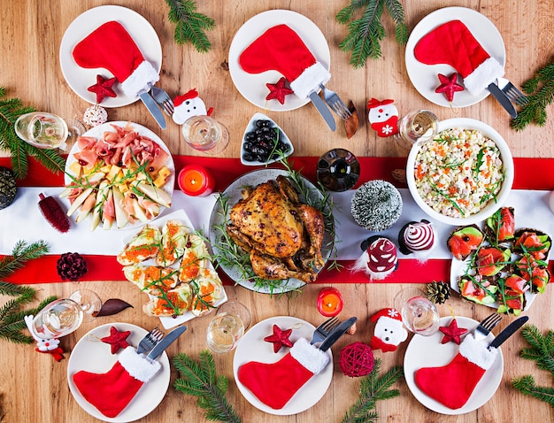 Baked turkey. christmas dinner. the christmas table is served with a turkey, decorated with bright tinsel and candles