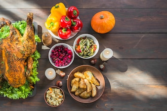 Baked turkey with bowls of food