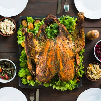 Baked turkey with salads on table