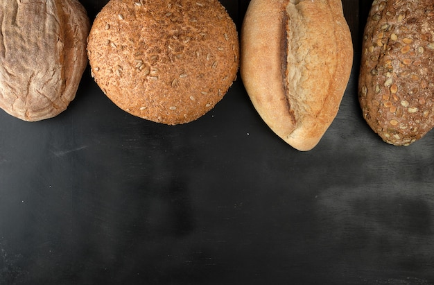 Baked various loaves of bread on a black