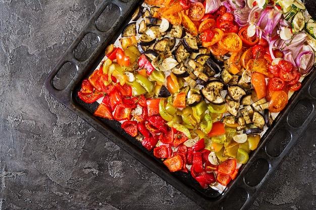 Baked vegetables on a baking sheet.
