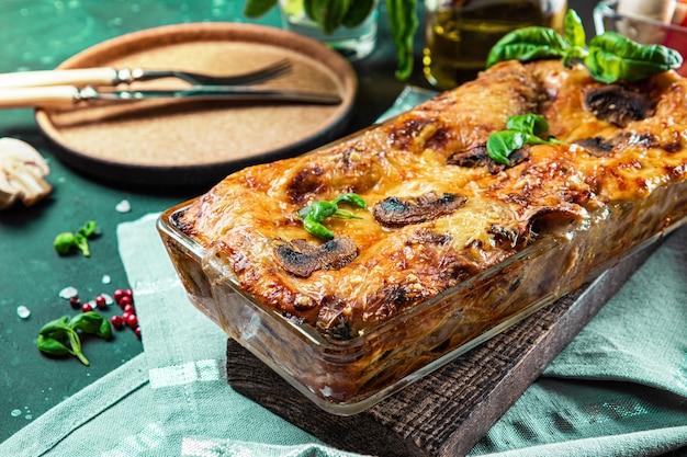 Baked vegetarian lasagna with mushrooms and basil