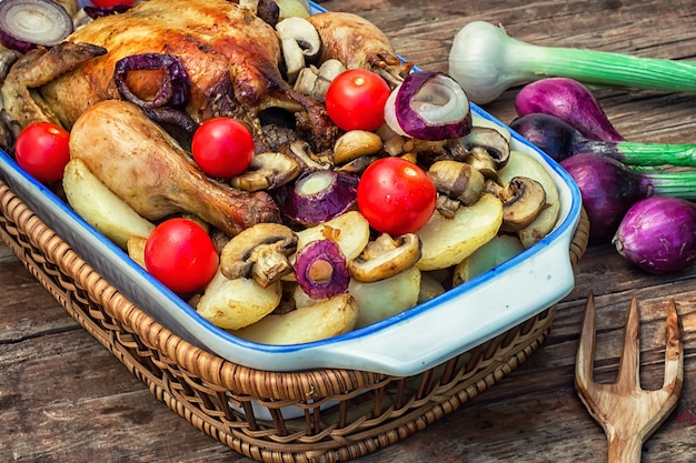 Baked whole chicken in vegetables