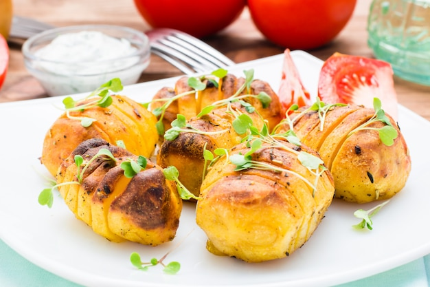 Baked young potatoes in spices and oil with arugula