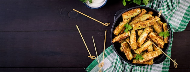 Baked zucchini sticks with cheese and bread crumbs