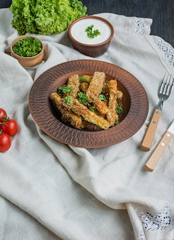 Baked zucchini with cheese and breadcrumbs. vegan food. vegetarian cuisine. view from above.  .