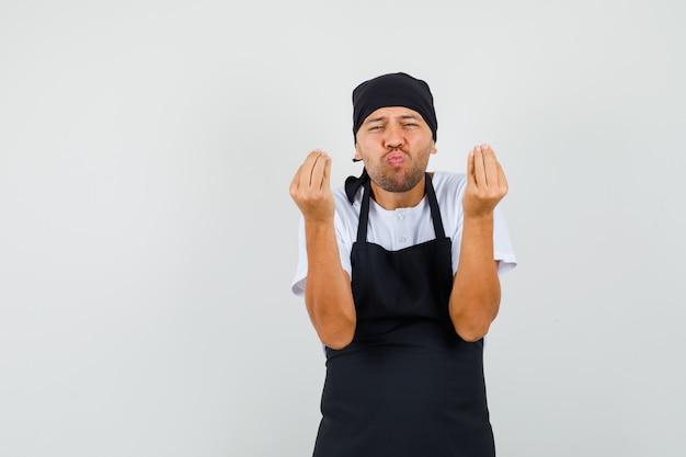 Baker man showing italian gesture, pouting lips in t-shirt