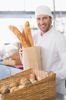 Baker showing basket of bread