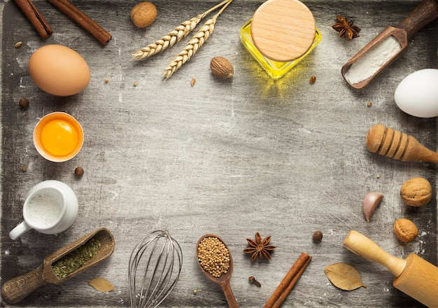 Bakery and bread ingredients on wooden background table, top view