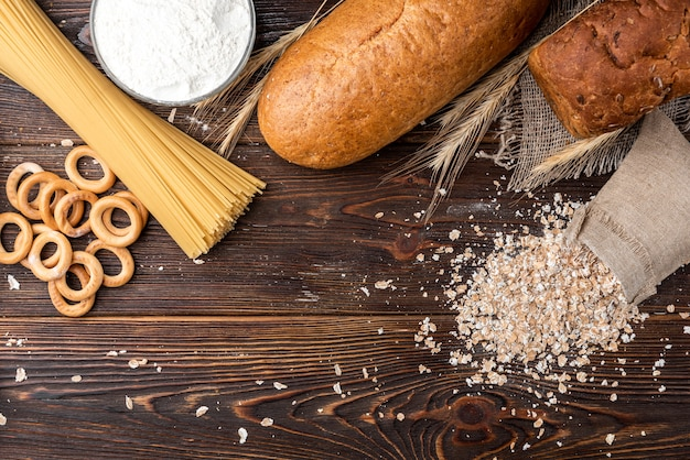 Bakery and pasta products on a wooden table