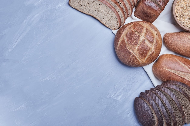 Bakery products on blue table on the kitchen towel.