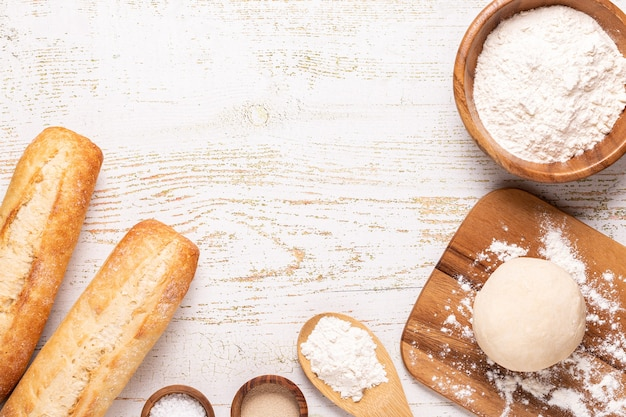 Bakery products -flour, dough, yeast, salt. top view, copy space.