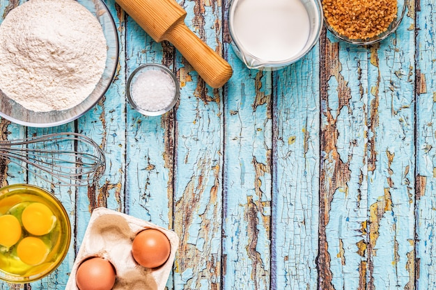 Bakery products -flour, eggs, milk. top view, copy space.