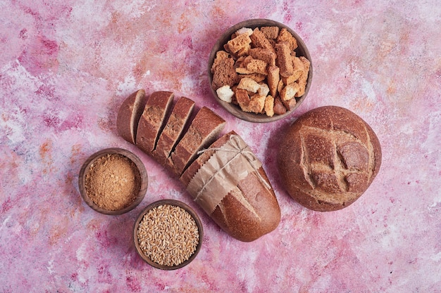 Bakery products on a pink table.