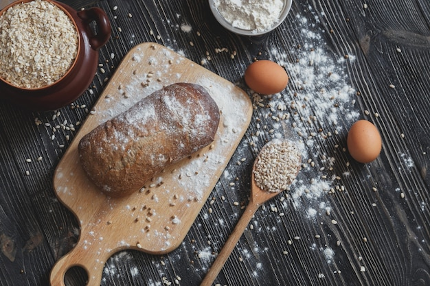 Baking bread at home on a rustic wooden table with space for text layout. top view.