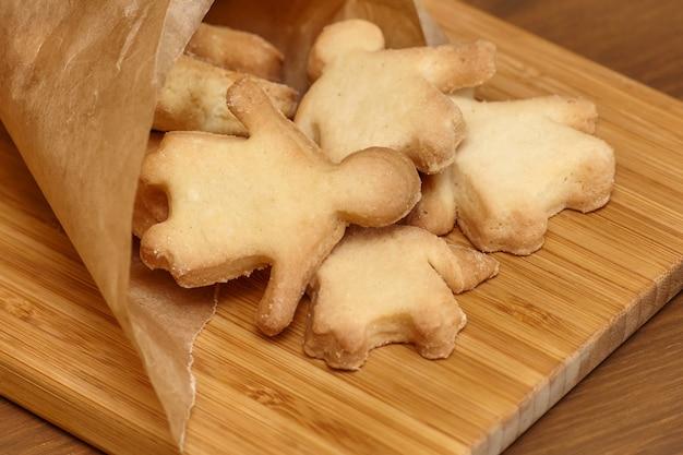 Baking gingerbread man cookies on wooden board