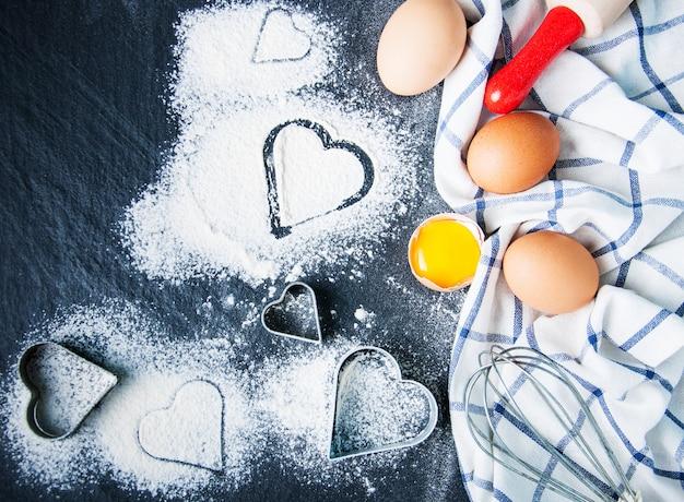 Baking ingredients on a black slate