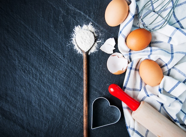 Baking ingredients on a black