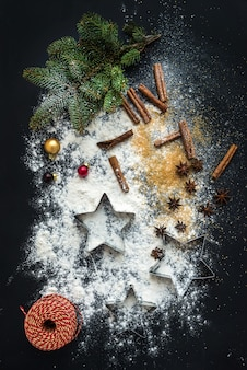 Baking ingredients for christmas holiday traditional gingerbread cookies preparation, black