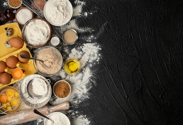 Baking ingredients for dough on black background, top view Premium Photo